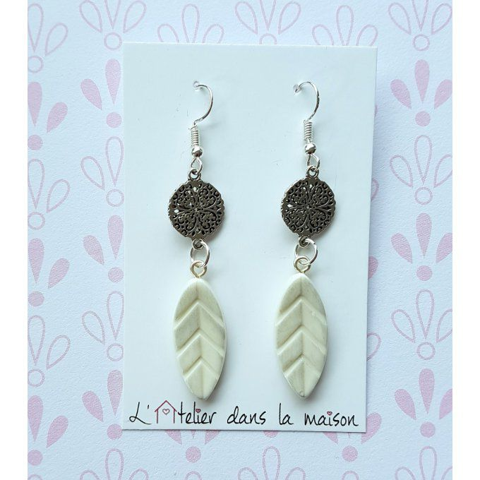 boucles plumes blanches